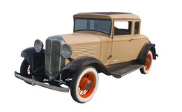 1930s tan coupe. Classic 1930s tan coupe with orange spoked wheels Stock Image