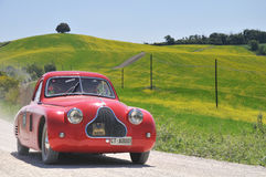 A 1938 red Fiat 508 CS MM stock photography