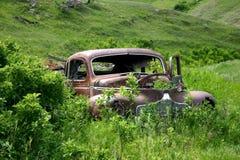 1940's era abandoned car. Abandoned 1940's era car in hills royalty free stock image