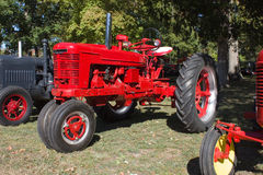 1940s Farm All Model H Tractor. 1940s Mc Cormeck Farm-All Model H tractor by International. This may be a 1941 model. Bright red, tricycle style front wheels royalty free stock photography
