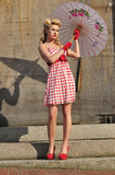 1940's starlet with umbrella. Gorgeous 1940's beauty standing with an umbrella Royalty Free Stock Photography