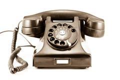 1940s Era Phone - Old Sepia Photo. Isolated on White Background royalty free stock image