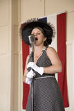 1940s style singer performing at Mid-Atlantic Air Museum Royalty Free Stock Photo