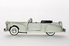 1941 Lincoln Continental classic toy car sideview. Picture of a 1941 Lincoln Zephyr classic toy car. From my brothers toy collection Royalty Free Stock Images