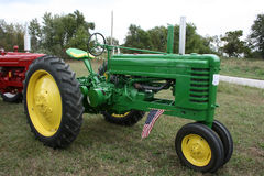 1943 John Deere Tractor_Flag. 1943 John Deere Tractor Model B.  A mid-size American made tractor from the 1940's.  Tricycle front wheels with large rear wheels Royalty Free Stock Images