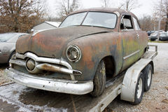 1949 Ford Sedan. 1949 Ford two door sedan awaiting restoration.  Chrome grill with a blue green and rust patina Royalty Free Stock Photos
