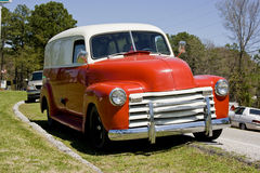 1950 Chevrolet Panel Truck. Nice red and white 1950 Chevy panel delivery truck, single cab, chrome grill and bumper Royalty Free Stock Image