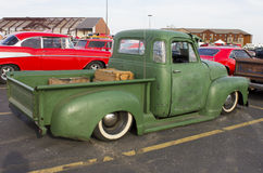 1950 Five Window Chevrolet Pickup Truck. Back and side view of a green 1950 Chevy pickup truck.  Five window cab, low rider, vintage rat rod Royalty Free Stock Photo