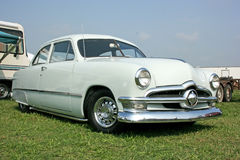 1950 Ford Sedan. Light mint green two-door with chrome rally wheels Stock Photography