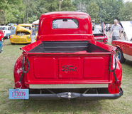 1950 Red Ford F1 Pickup back view. WAUPACA, WI - AUGUST 25: Back view of 1950 Ford F1 red Pickup truck at the 10th Annual Waupaca Rod & Classic Car Club Car Show stock photography