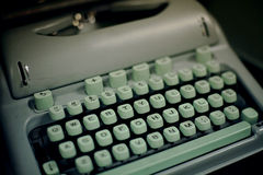 1950's vintage typewriter. Green vintage style typewriter with keys that pop out Stock Photography