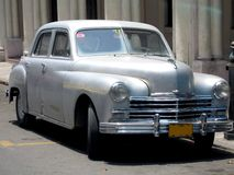 1950 silver car in Havana. Old 1950 silver car parked in a street in Havana (Cuba royalty free stock images