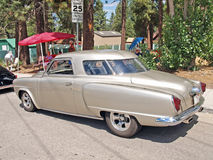 1950 Studebaker Champion. This is a nicely restored champagne colored 1950 Studebaker Champion with after market chrome wheels stock images