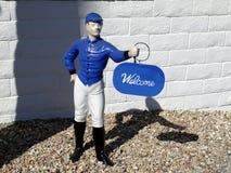 1950s: Blue lawn jockey welcome. Blue lawn jockey 1950s garden ornament, Palm Springs, California Stock Photography