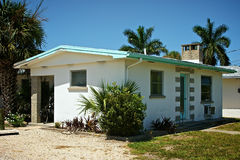 1950s florida home. Old small cement florida home from the 1950's with palm trees Royalty Free Stock Photo