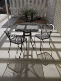 1950s Modernist garden: table and chairs Royalty Free Stock Photography