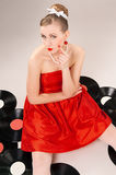 1950s Style. The girl in the style of 60's with vinyl records, underground music royalty free stock photo