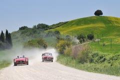1954 Maserati en 1955 Alfa Romeo bij 1000 Miglia Stock Afbeeldingen