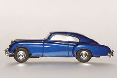 1955 Bentley 'R' Continental classic toy car sideview. Picture of a 1955 Bentley 'R' Continental classic toy car. From my brothers toy collection Royalty Free Stock Photography