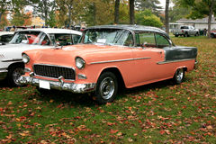 1955 Chevy Bel Aire Hardtop. Two tone 1955 Chevrolet Bel Aire hardtop.  Two door sedan painted with a peach and gray color combination. Photo shows the front and Stock Photo