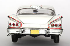 1958 Chevrolet Impala metal scale toy car backview. Picture of a 1958 Chevrolet Impala. Detailed scale model from my brothers toy collection Royalty Free Stock Images