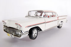 1958 Chevrolet Impala metal scale toy car wideangel. Picture of a 1958 Chevrolet Impala. Taken with extrem wideangel as a highkey picture. Detailed scale model Royalty Free Stock Images