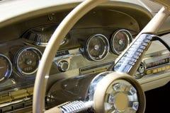 1958 Ford Edsel Dash & Steering Wheel. 1958 Ford Edsel two-door hardtop, vintage gauges, steering wheel, door and instrument panel Stock Images