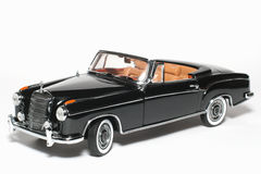 1958 Mercedes Benz 220 SE metal scale toy car. Picture of a 1958 Mercedes Benz 220 SE. Detailed scale model from my brothers toy collection Royalty Free Stock Photos
