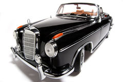 1958 Mercedes Benz 220 SE metal scale toy car fisheye #3. Picture of a 1958 Mercedes Benz 220 SE. Taken with a fisheye lens as a highkey picture. Very hard to Royalty Free Stock Images