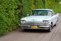 1959 Chrysler New Yorker. ROSMALEN, THE NETHERLANDS - MAY 16: 1959 Chrysler New Yorker arriving on the Rock Around the Jukebox Open Air event on May 16, 2010 in Stock Photos
