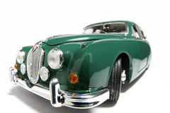 1959 Jaguar Mark 2 metal scale toy car fisheye. Picture of a 1959 Jaguar Mark 2. Taken with a fisheye lens as a highkey picture. Very hard to flash as the Stock Image