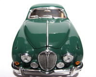 1959 Jaguar Mark 2 metal scale toy car fisheye frontview #2. Picture of a 1959 Jaguar Mark 2. Taken with a fisheye lens as a highkey picture. Very hard to flash Royalty Free Stock Images