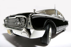 1960 Ford Starliner metal scale toy car fisheye. Picture of a 1960 Ford Starliner.  Taken with a fisheye lens as a highkey picture. Very hard to flash as the Royalty Free Stock Images