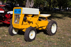 1960s Lawn and Garden Tractor. 1965 International Cub Cadet lawn tractor or mower.  Tractor that is used for mowing, plowing and hauling.  Painted bright yellow Royalty Free Stock Images