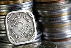1963 printed 5 Paisa indian currency coin. With stack of other coins in the background Royalty Free Stock Photography
