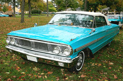 1964 Ford Galaxie Convertible. Frotn and side view of a 1964 Ford Galaxie convertible, color is Robin's Egg Blue. Original appearance with stock wheels and royalty free stock images
