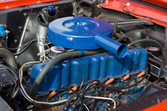 1966 Ford Mustang 6 Cylinder Engine 200. 1966 Ford Mustang six cylinder engine, painted blue with blue air cleaner assembly. Factory 200 cubic inch motor Royalty Free Stock Photos