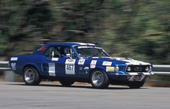 1967 Ford Mustang. Jonathan Hills the brakes in his 1967 Ford Mustang on the approach to the Windy Point hairpin on the 2007 Classic Adelaide Tarmac Rally royalty free stock photos