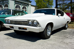 1968 Chevrolet Chevelle. White 1968 Chevrolet Chevelle two door hardtop, cowl hood, chrome wheels Royalty Free Stock Photography
