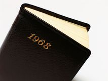 1968 Diary. A small palm size diary dated to 1968. Isolated on white background. Low DOF Royalty Free Stock Image
