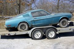 1968 Mustang Fastback Rebuild. 1968 Ford Mustang fastback rebuilder loaded on a transport trailer.  This car is a restoration project with heavy rust.  It is on Royalty Free Stock Image