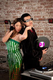 1970s Disco Music Party. Cool Asian Couple at a 1970s Disco Music Party royalty free stock images