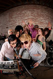 1970s Disco Music Party. Singing DJs at a 1970s Disco Music Party stock photo
