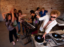 1970s Disco Music Party. Changing records at a 1970s Disco Music Party royalty free stock images