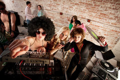 1970s Disco Music Party. Female DJs checking out the scene at a 1970s Disco Music Party royalty free stock image