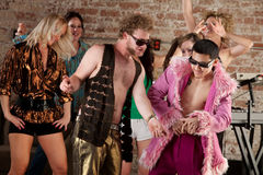1970s Disco Music Party. Seven dancers at a 1970s Disco Music Party royalty free stock photos