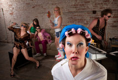 1970s Disco Music Party. Angry lady in bathrobe crashing a 1970s Disco Music Party Stock Photos