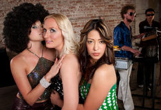 1970s Disco Music Party. Cute girls embracing at a 1970s Disco Music Party stock photography
