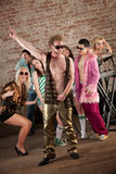 1970s Disco Music Party. Disco posing with friends at a 1970s Disco Music Party royalty free stock photos