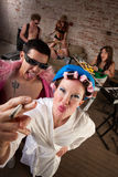 1970s Disco Music Party. Funny woman in curlers teased at a 1970s Disco Music Party Stock Image